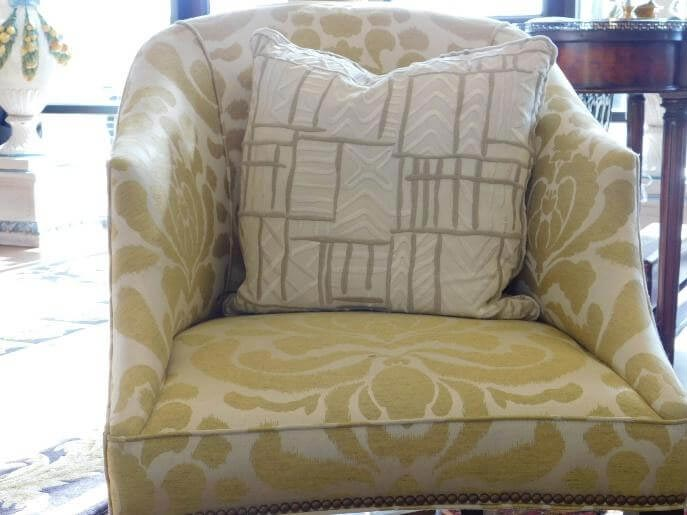 Older barrel back chair restored with a touch of yellow fabrics