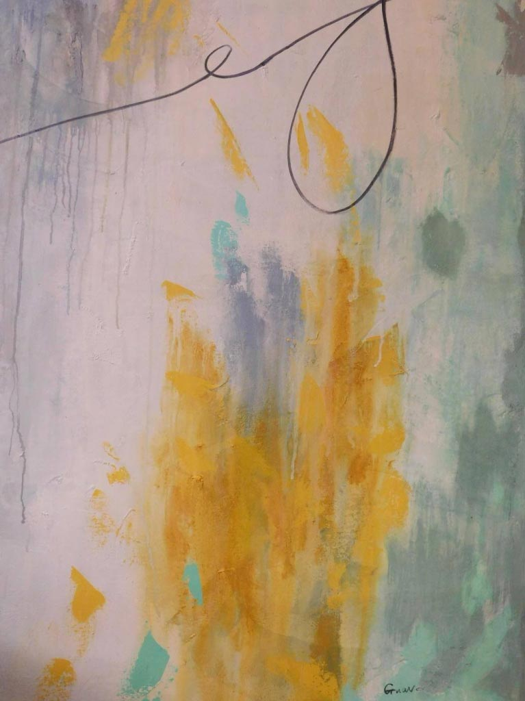 Painting with splash of yellow paint and complementing a teal background