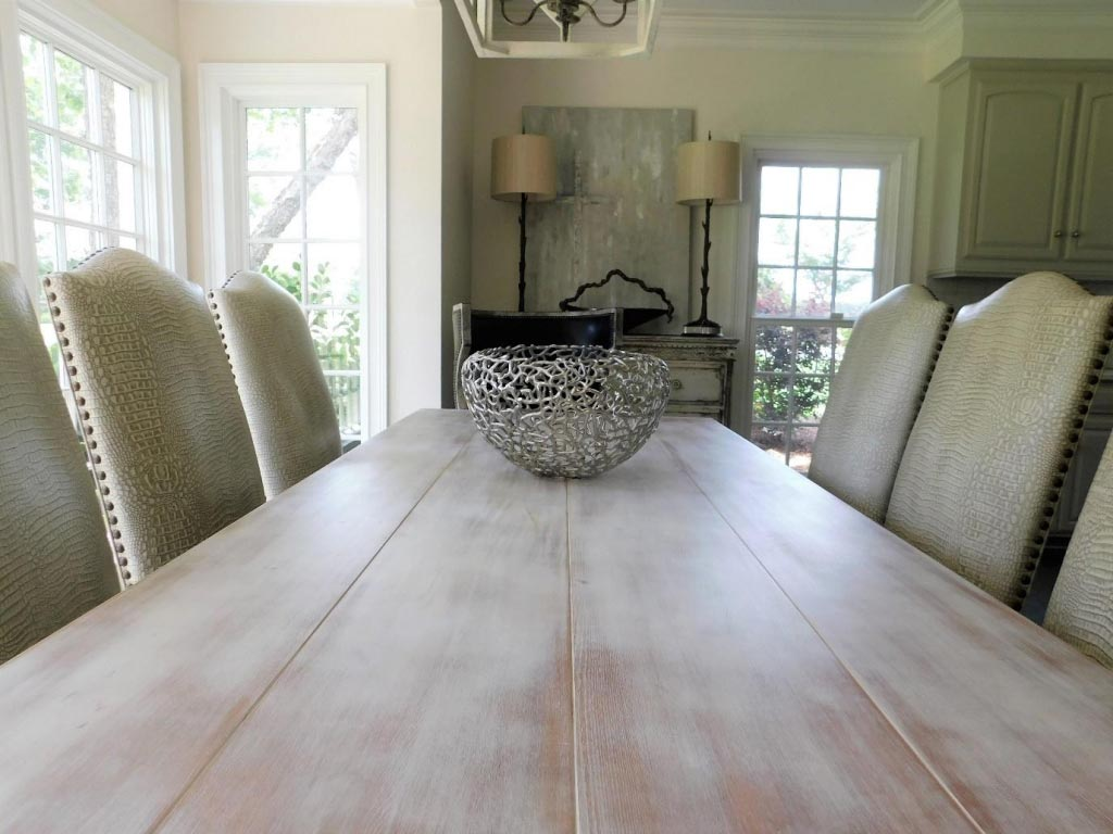 Rustic whitewashed table in large open space dining area charming leather chairs