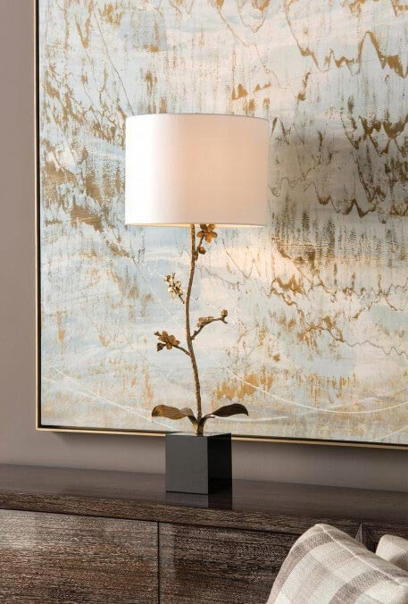 Lamp whose stem is inspied by floral patterns