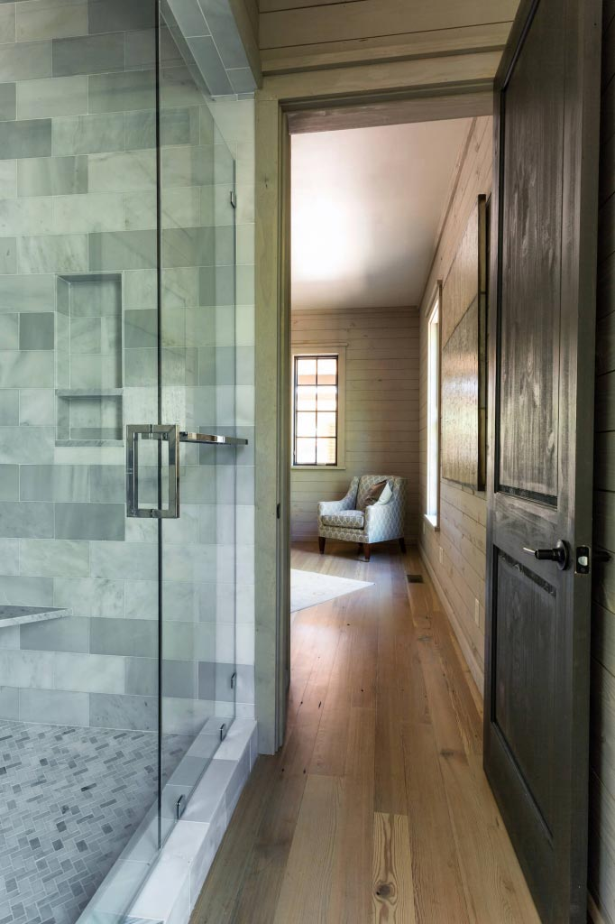 Bathroom exit/entrance, tiled shower with glass doors