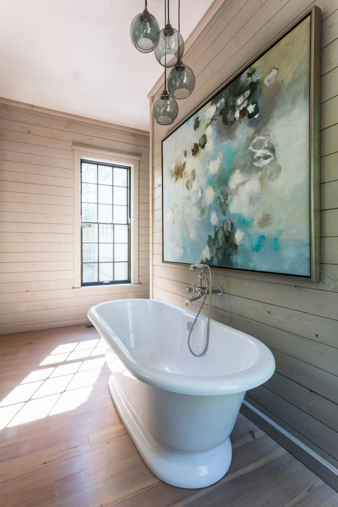 Farmhouse bathroom with brand new bathtub and great attention paid to the negative spacei in the design