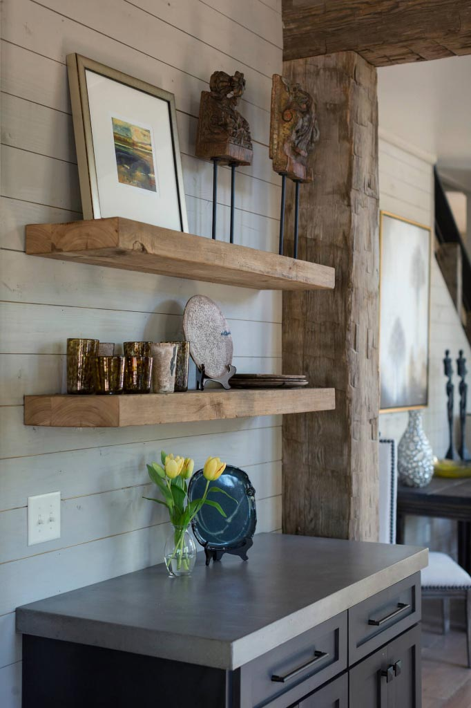 Floating shelves holding high-end accessories